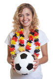 German female soccer fan with ball Royalty Free Stock Photography
