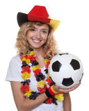 German female soccer fan with hat and ball Royalty Free Stock Photography