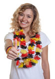 German female sports fan showing thumb up. On an isolated white background for cut out Royalty Free Stock Images