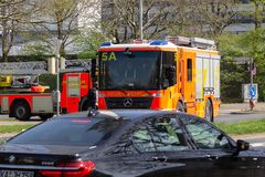German fire service vehicles from the professional fire department drive to a deployment site. Royalty Free Stock Photo