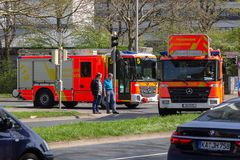 German fire service vehicles from the professional fire department drive to a deployment site. Royalty Free Stock Image