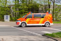 German fire service vehicles from the professional fire department drive to a deployment site. HANNOVER / GERMANY - APRIL 18, 2018: German fire service vehicles Royalty Free Stock Photo