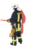 German Firefighter. In uniform.  Isolated against a white background Royalty Free Stock Images