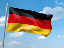 German flag. An image of a German flag in the blue sky Royalty Free Stock Photo