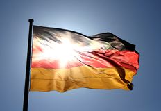 German Flag. With the sun shining through it near the Reichstag in Berlin Stock Images