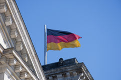 German Flag. The German flag on top of the German parliament building, the Reichstag at Berlin, Germany Stock Photos