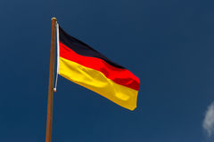 German flag. In front of a blue sky royalty free stock image