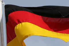 German flag. The German flag flying in the wind Royalty Free Stock Images