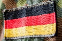 German flag appliquéd on military jacket Stock Photo