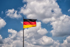 German flag on a background of the sky Stock Image