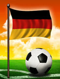 German flag and ball. On soccer field Stock Photography
