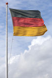 German flag. Blowing in the wind royalty free stock photography