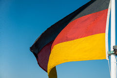 German flag on blue sky background Royalty Free Stock Photos