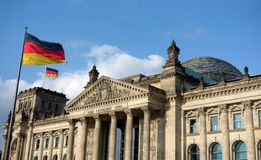 German Flag At Bundestag Building Berlin. German flag waving at Bundestag building in Berlin Germany in a sunny day with blue sky Royalty Free Stock Images