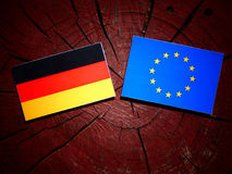 German flag with EU flag on a tree stump isolated Stock Images