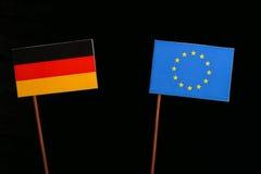 German flag with European Union EU flag  on black Stock Images