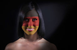 German flag face. On a woman Royalty Free Stock Image