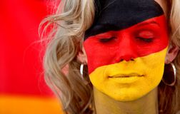 German flag - female face Stock Photography