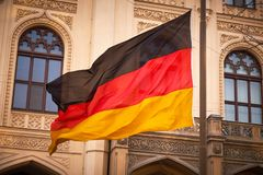 German flag on flagpole. Waving in the wind Stock Photography