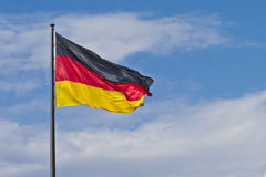 German flag. Flying in the wind Royalty Free Stock Photos