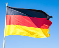 German flag. In front of blue sky royalty free stock photos
