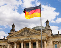German Flag in front of the Bundestag. A german flag in front of the Bundestag, the seat of the German Government in Berlin stock photo