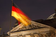 German Reichstag With Flag At Night stock image