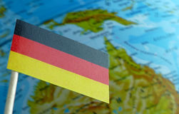 German flag with a globe map as a background Stock Photo