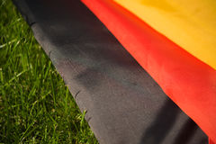 German flag on the green grass. Closeup, background Royalty Free Stock Photo