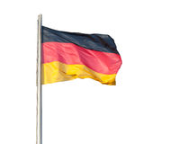 German Flag Isolated on a White Background. The German flag flying on a metal pole, isolated on a white background stock photography