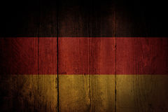 German flag. German flag over a grunge wooden background royalty free stock photo