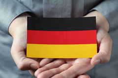 German flag in palms Royalty Free Stock Image