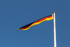 German Flag. Photograph of a long and thin German flag Royalty Free Stock Image