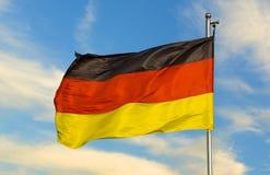 German flag on a pole. Against beautiful sky stock photo