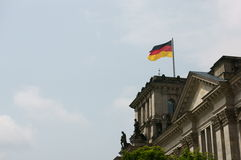 German flag of the Reichtag building. The waving german flag of the Reichtag building in Berlin, Germany Stock Photo