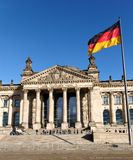 German Flag Streaming before the German Parliament. The German flag streaming in front of the German parliament building, the Reichstag at Berlin, Germany Stock Images