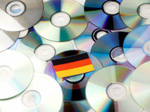 German flag on top of CD and DVD pile isolated on white. German flag on top of CD and DVD pile isolated Royalty Free Stock Photos
