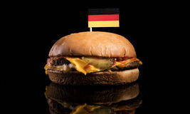 German flag on top of hamburger isolated on black Royalty Free Stock Photos