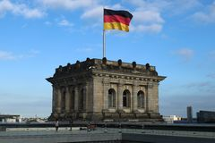 German Flag. On top of parliament building stock photography