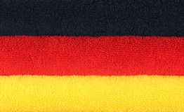German Flag Towels. A stack of towels in the arranged in the colors of the German flag Royalty Free Stock Photos