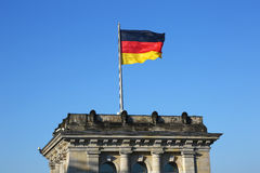 German flag waving on Bundestag in Berlin Royalty Free Stock Photos