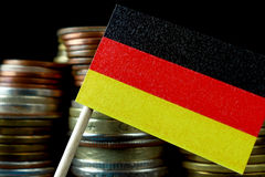 German flag waving with stack of money coins Royalty Free Stock Photography