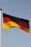 German flagpole. The German flag flying from a flagpole flapping in the wind Royalty Free Stock Photo