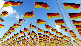 German Flags on flagpoles against blue sky Royalty Free Stock Images