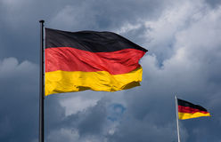 German flags in front of dark clouds Royalty Free Stock Photo
