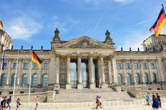 German flags waving in the wind at Reichstag building, seat of the German Parliament Deutscher Bundestag, on a sunny day with bl Royalty Free Stock Images