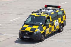 German  follow me  car drives on airport Royalty Free Stock Photo