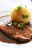 German food Sauerbraten with knodel Royalty Free Stock Photo