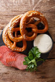 German food: sliced sausages and pretzels with cream sauce close stock images