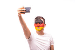German football fan take selfie photo with phone on white background. Royalty Free Stock Images